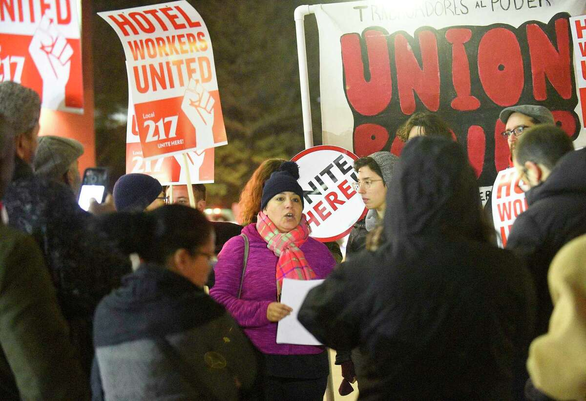 Mariela Sanchez, a housekeeper with the Sheraton Hotel, center, reads a prepared statement as she and several hotel workers from the hotel hold a rally on Nov. 21, 2019 in Stamford, Connecticut. Employees filed a formal complaint with OSHA on Thursday about unsafe working conditions at the hotel. Some of the allegations against the hotel administration is that workers say they are exposed to concentrated chemicals and are not given the appropriate protection from them. Late last year, employees voted to form a union by joining UNITE HERE Local 217 and have been vocal against hotel leadership.
