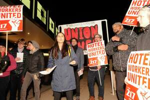 Talia Stender, center, with the Yale Law School Worker and Immigrant Rights Advocacy Clinic, speaks out as hotel workers from the Stamford Sheraton protest outside the hotel on Nov. 21.