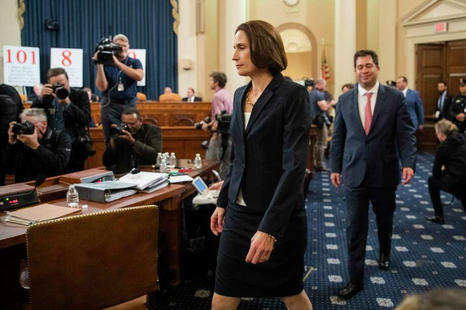 Former White House national security aide Fiona Hill, walks to her seat to testify before the House Intelligence Committee on Capitol Hill in Washington, Thursday, Nov. 21, 2019, during a public impeachment hearing of President Donald Trump's efforts to tie U.S. aid for Ukraine to investigations of his political opponents. (AP Photo/Manuel Balce Ceneta) Photo: Manuel Balce Ceneta, STF / Associated Press / Copyright 2019 The Associated Press. All rights reserved.