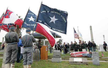 The Sons of Confederate Veterans of the Civil War, John Bell Hood Camp No. 50, and the Sons of Union Veterans of the Civil War, Lt. Cmdr. Edward Lea, USN Camp No. 2, host a reenactment of the funeral of Lt. Cmdr. Edward Lea and Cmdr. Jonathon Wainwright from the USS Harriet Lane at Trinity Episcopal Cemetery in 2013 as part of a reenactment of the Civil War Battle of Galveston, Texas. (AP Photo/The Galveston County Daily News, Kevin M. Cox) MANDATORY CREDIT; TV OUT