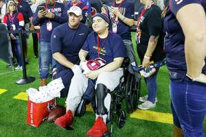 Houston Texans J.J. Watt spends time with Anthony Murillo, 18, of Crosby with Make-A-Wish before the start of an NFL football game at NRG Stadium, Thursday, Nov. 21, 2019, in Houston.