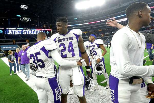 Newton's Maliak Metoyer congratulates James Sylvester as the Eagles line up for their medals after beating Candian during their state final Class 3A Div. II game at AT&T Stadium. Photo taken Thursday, December 20, 2018 Kim Brent/The Enterprise