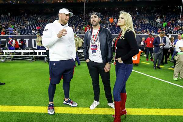 J.J. Watt talks to Justin Verlander and Kate Upton from the sideline before the start of an NFL football game at NRG Stadium, Thursday, Nov. 21, 2019, in Houston.
