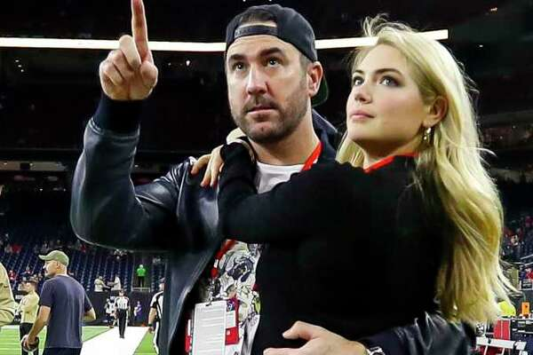 Justin Verlander and Kate Upton watch from the sideline before the start of an NFL football game at NRG Stadium, Thursday, Nov. 21, 2019, in Houston.