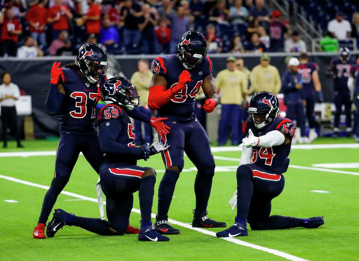 Texans linebackers Jacob Martin (54) and Whitney Mercilus (59) will both miss this week's game against the Jacksonville Jaguars.