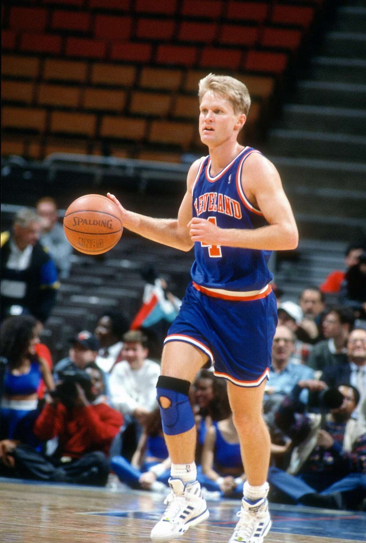 MILWAUKEE, WI - CIRCA 1991: Steve Kerr #5 of the Cleveland Cavaliers dribbles the ball up court against the Milwaukee Bucks during an NBA basketball game circa 1991 at the MECCA Arena in Milwaukee, Wisconsin. Kerr played for the Cavaliers from 1989-92. ~