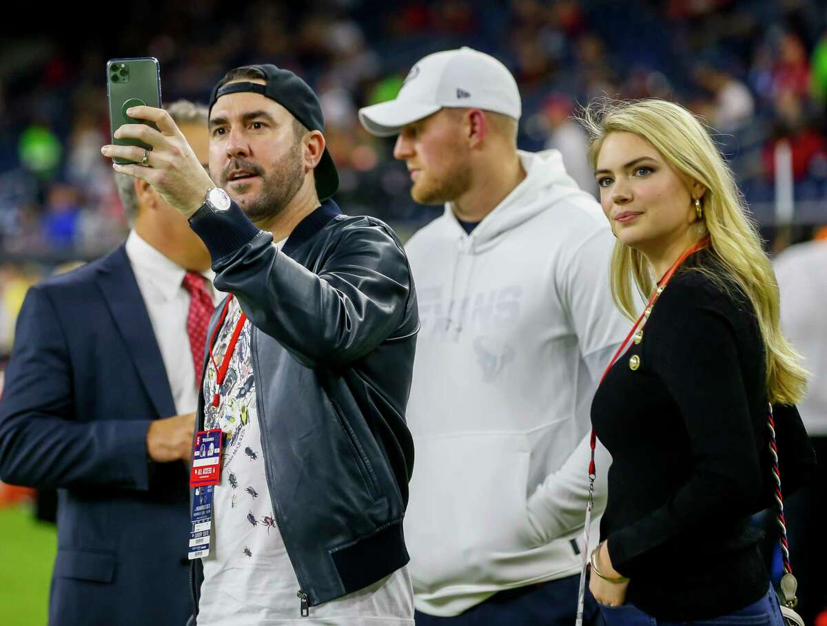 Kate Upton and Justin Verlander watch from the sidelines before an NFL football game at NRG Stadium on Thursday, Nov. 21, 2019, in Houston.
