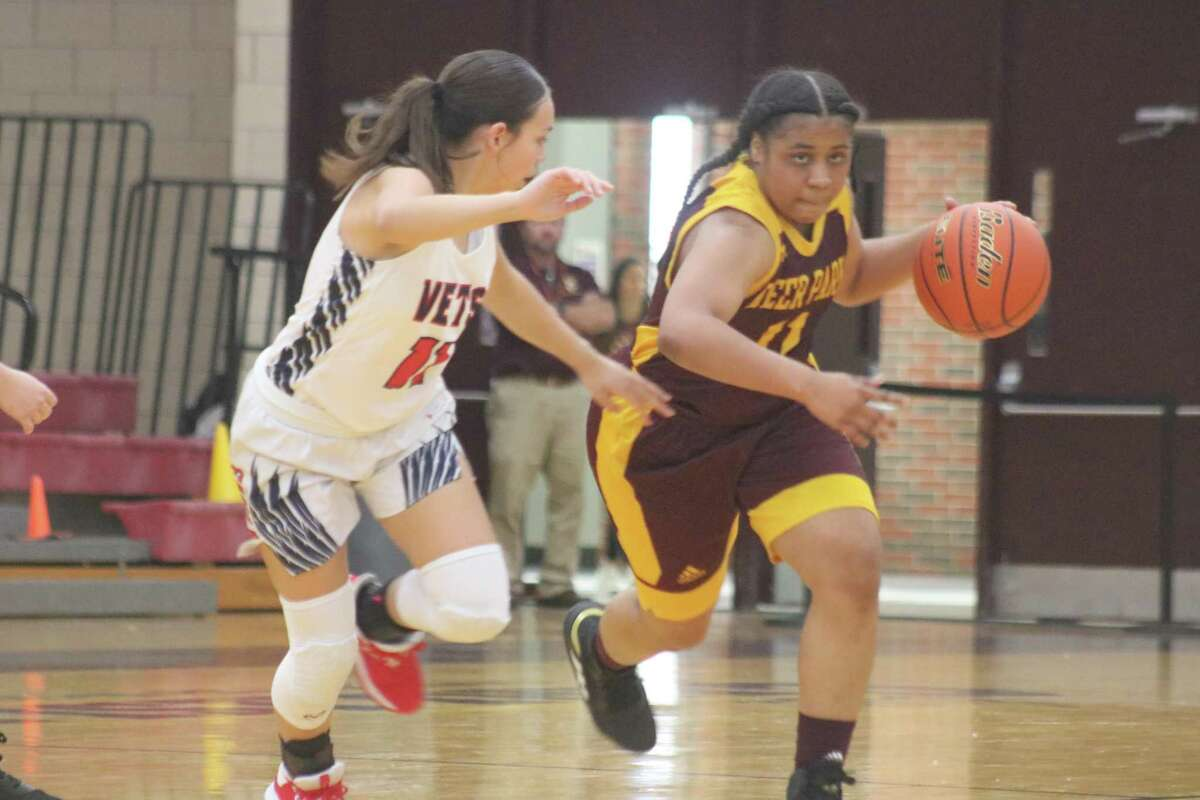 Enriqua Bellow dribbles across the mid-court stripe as a Veterans Memorial defender gives chase during Thursday's game at Watkins Gym.