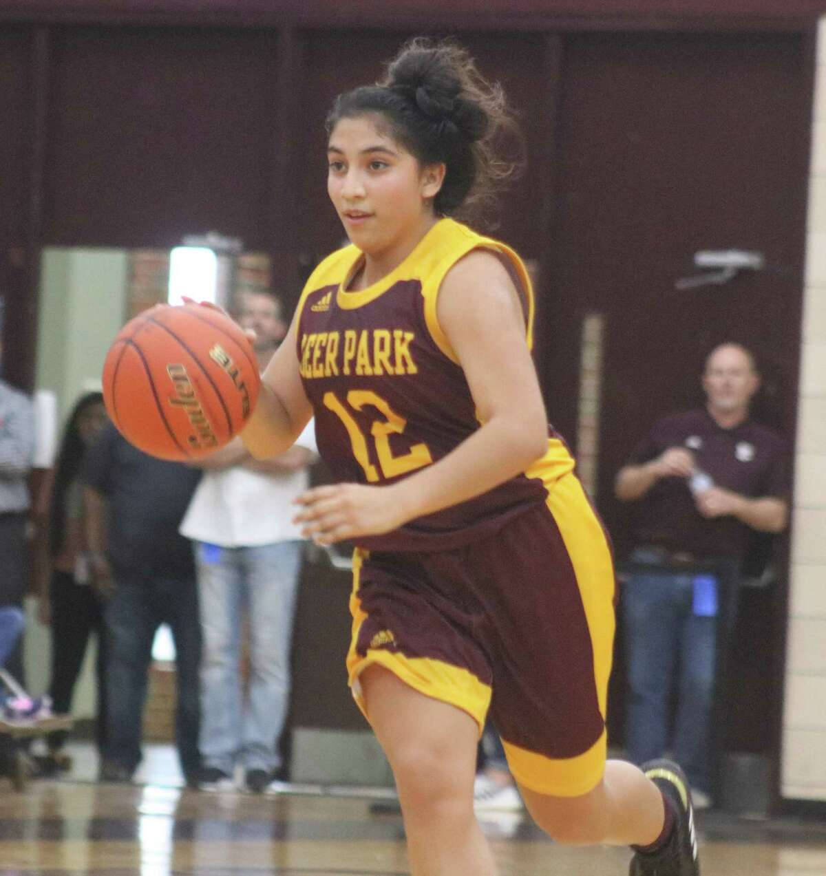 Celeste Lemus, who drained the last-second bucket that forced overtime, looks for an open teammate in the team's first game of the Texas Invitational.