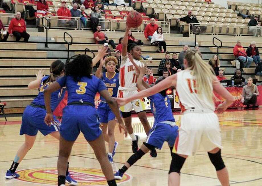 Ferris State junior point guard Shaniya Huggins avoids defenders as she looks to make a pass during the Bulldogs' 93-66 win over Ursuline Thursday night at Jim Wink Arena. (Pioneer photo/Joe Judd)