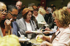 People wait in long lines to be served at Taste of Downtown 2019, a fundraiser for Alton Main Street Thursday at the Argosy Casino. About 400 people came out for the event, which included chances to taste samples from more than a dozen area restaurants, music and prizes.