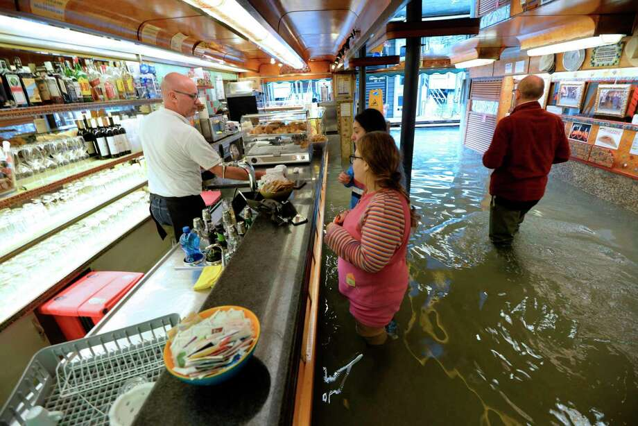 Record flooding has swamped Venice with experts citing climate change as the cause. But a reader notes this isn't the first time Venice has experienced record flooding. Photo: Andrea Merola /Associated Press / ANSA