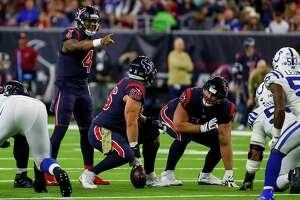 Houston Texans quarterback Deshaun Watson (4) communicates with Houston Texans center Nick Martin (66) during the second quarter of an NFL football game at NRG Stadium on Thursday, Nov. 21, 2019, in Houston.