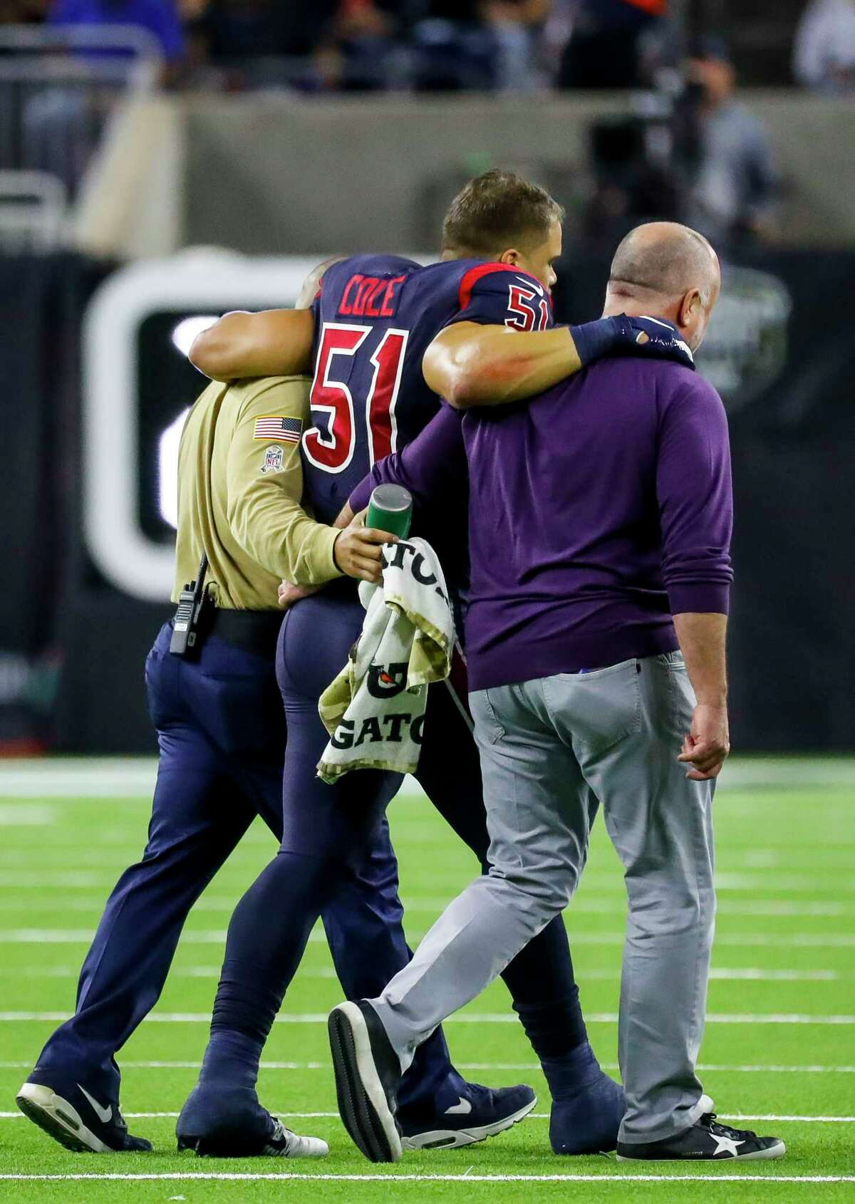 Houston Texans linebacker Dylan Cole (51) is helped off the field during the second quarter of an NFL football game at NRG Stadium, Thursday, Nov. 21, 2019, in Houston.