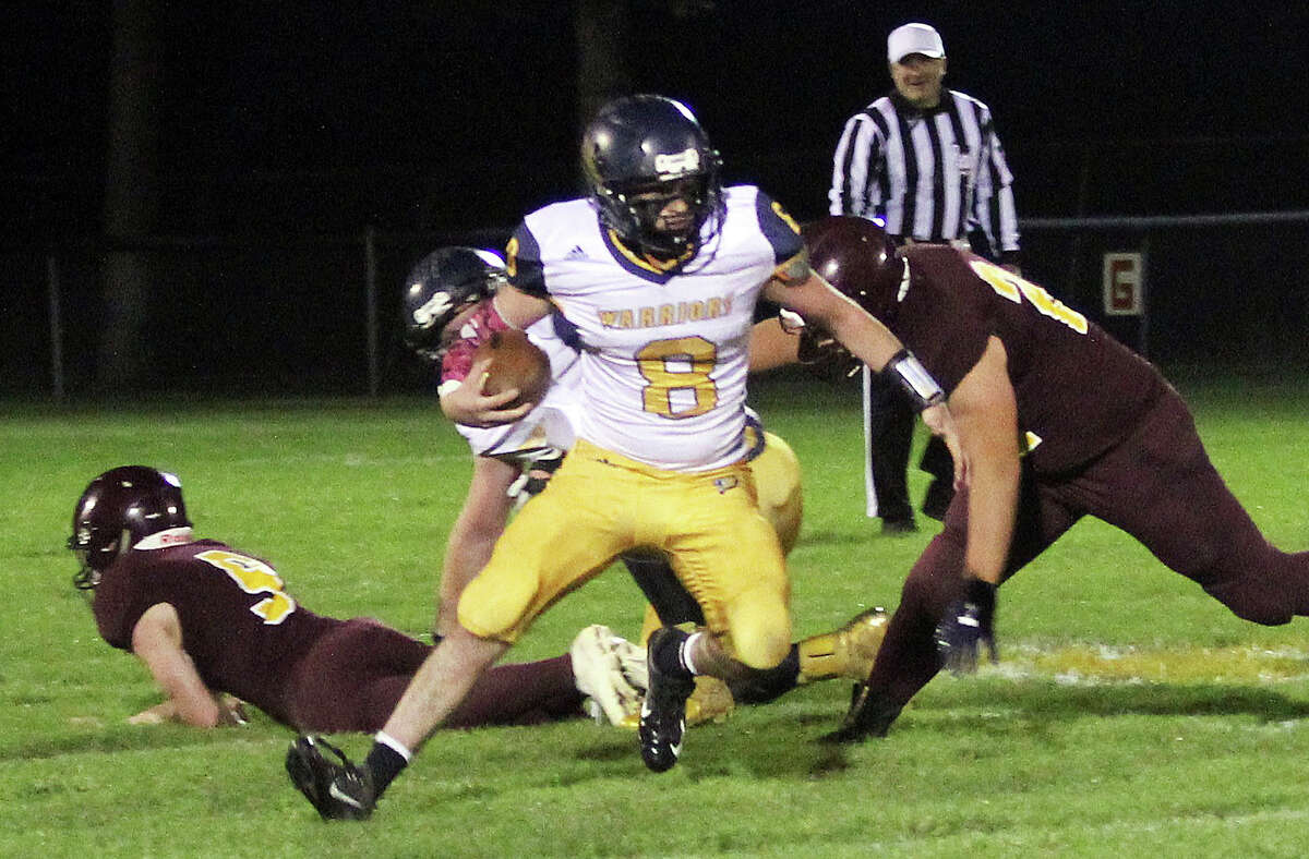 Chris Augle (8) evades Deckerville defenders during a game in October.