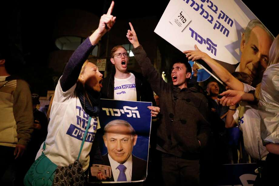 Supporters of Israeli Prime Minister Benjamin Netanyahu gather outside his residence in Jerusalem, Thursday, Nov. 21, 2019. Israel's attorney general charged Netanyahu with fraud, breach of trust and accepting bribes in three different scandals. It is the first time a sitting Israeli prime minister has been charged with a crime. (AP Photo/Ariel Schalit) Photo: Ariel Schalit / Copyright 2019 The Associated Press. All rights reserved.