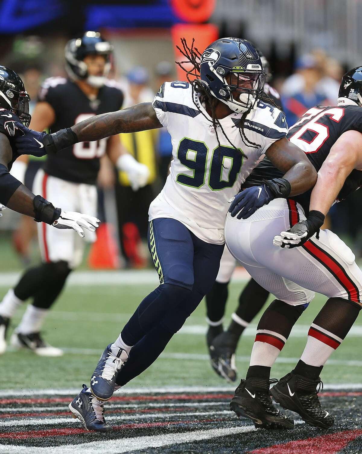 Seattle Seahawks defensive end Jadeveon Clowney (90) runs in the backfield in a week 7 NFL football game against the Atlanta Falcons, Sunday, Sep. 27, 2019 in Atlanta. (Michael Zarrilli/AP Images for Panini, via AP)