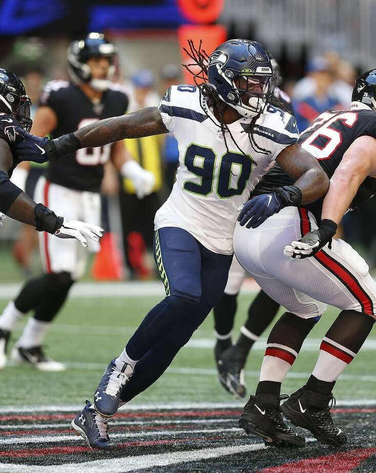 Seattle Seahawks defensive end Jadeveon Clowney (90) runs in the backfield in a week 7 NFL football game against the Atlanta Falcons, Sunday, Sep. 27, 2019 in Atlanta. (Michael Zarrilli/AP Images for Panini, via AP) Photo: Michael Zarrilli, Associated Press