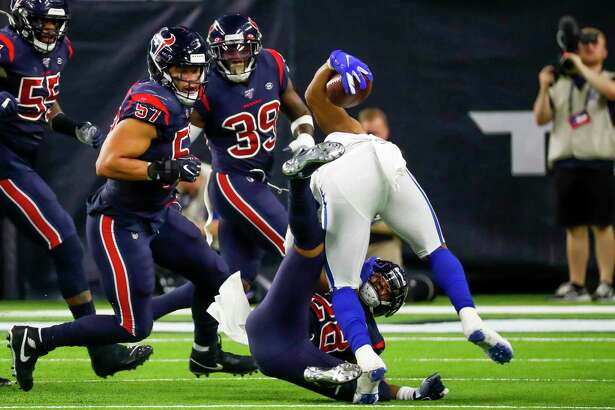 Houston Texans cornerback Vernon III Hargreaves (28) pulls down Indianapolis Colts running back Nyheim Hines (21) during the third quarter of an NFL football game at NRG Stadium on Thursday, Nov. 21, 2019, in Houston.