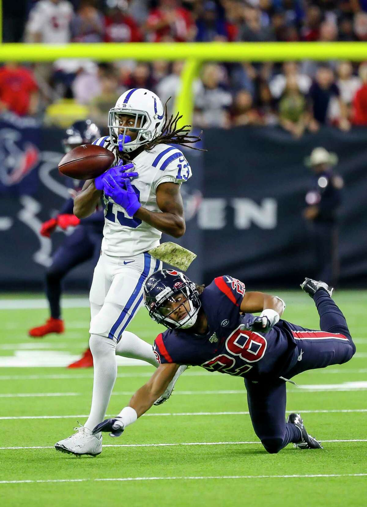 Indianapolis Colts wide receiver T.Y. Hilton (13) can not hold onto a pass from Indianapolis Colts quarterback Jacoby Brissett (7) through coverage by Houston Texans cornerback Vernon III Hargreaves (28) during the third quarter of an NFL football game at NRG Stadium, Thursday, Nov. 21, 2019, in Houston.