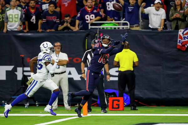 Houston Texans wide receiver DeAndre Hopkins (10) catches a 30-yard touchdown pass from Houston Texans quarterback Deshaun Watson (4) over Indianapolis Colts cornerback Pierre Desir (35) to give the Texans a 20-17 lead over the Colts during the fourth quarter of an NFL football game at NRG Stadium on Thursday, Nov. 21, 2019, in Houston.