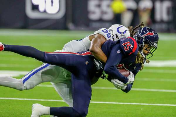 Houston Texans wide receiver Will Fuller (15) is tackled after a reception by Indianapolis Colts cornerback Marvell Tell (39) during the fourth quarter of an NFL football game at NRG Stadium, Thursday, Nov. 21, 2019, in Houston.