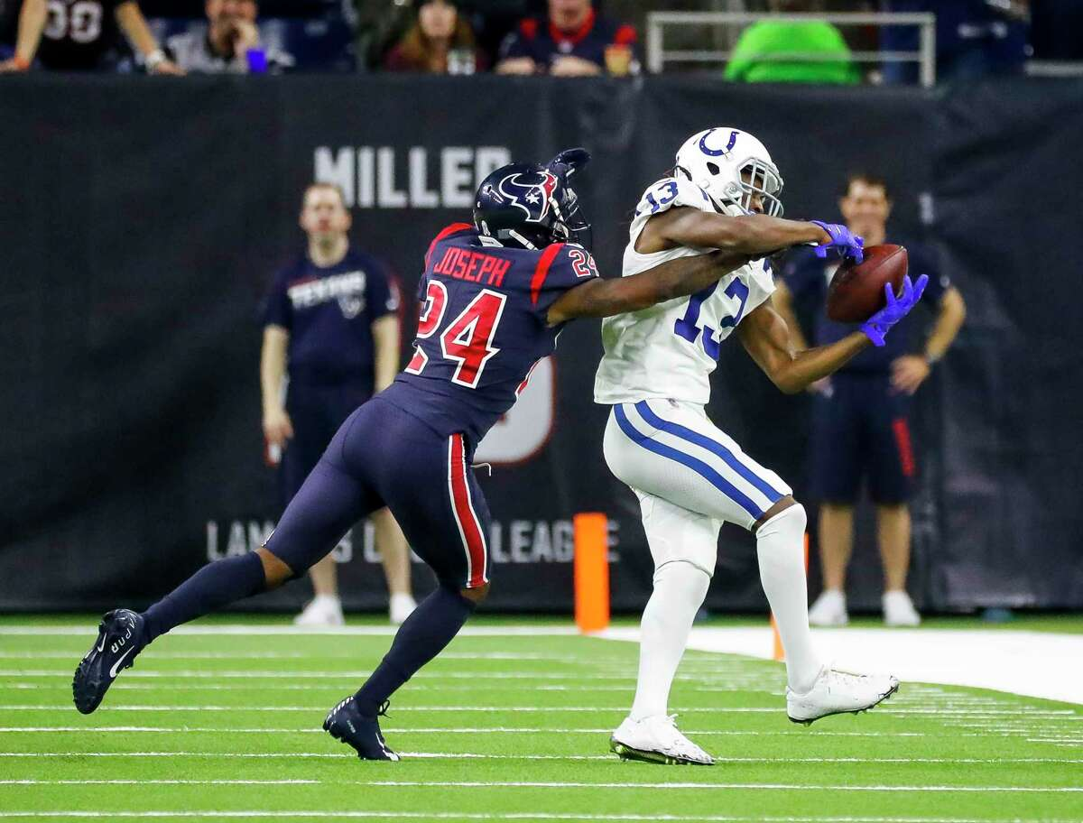Texans cornerback Johnathan Joseph (24) knocks away a pass intended for Colts wide receiver T.Y. Hilton (13) to stop a drive during the fourth quarter Thursday at NRG Stadium.