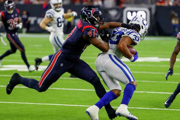 Houston Texans inside linebacker Zach Cunningham (41) tries to tackle Indianapolis Colts running back Jonathan Williams (33) during the third quarter of an NFL football game at NRG Stadium on Thursday, Nov. 21, 2019, in Houston.