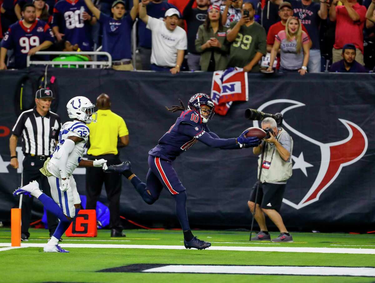 DeAndre Hopkins hauls in the go-ahead touchdown for the Texans early in the fourth quarter Thursday against the Colts at NRG Stadium.
