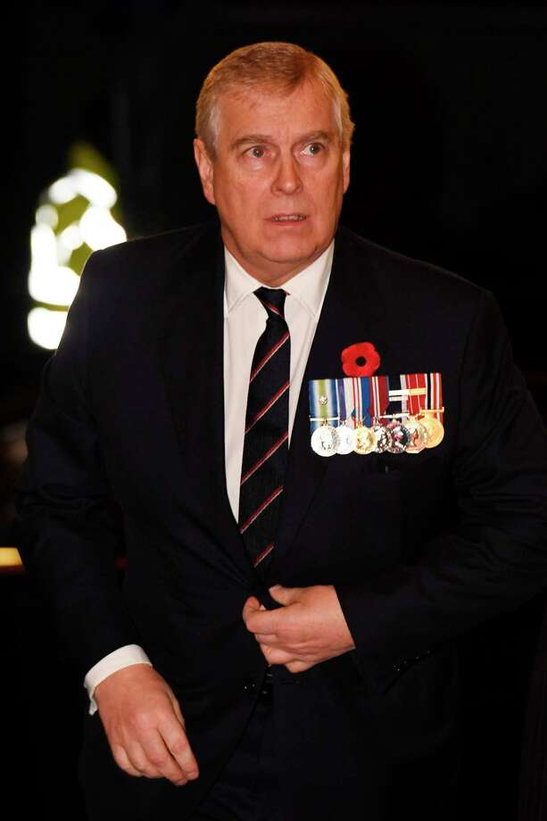 (FILES) In this file photo taken on November 11, 2017 Britain's Prince Andrew, Duke of York, arrives for the the annual Royal Festival of Remembrance at the Royal Albert Hall in London on November 11, 2017 on Armistice Day. - Prince Andrew on November 20, 2019 said he was cancelling his public engagements, as the outcry from the British royal's friendship with convicted sex offender Jeffrey Epstein showed no sign of abating. (Photo by Stefan Rousseau / POOL / AFP) (Photo by STEFAN ROUSSEAU/POOL/AFP via Getty Images) Photo: STEFAN ROUSSEAU / AFP and Licensors