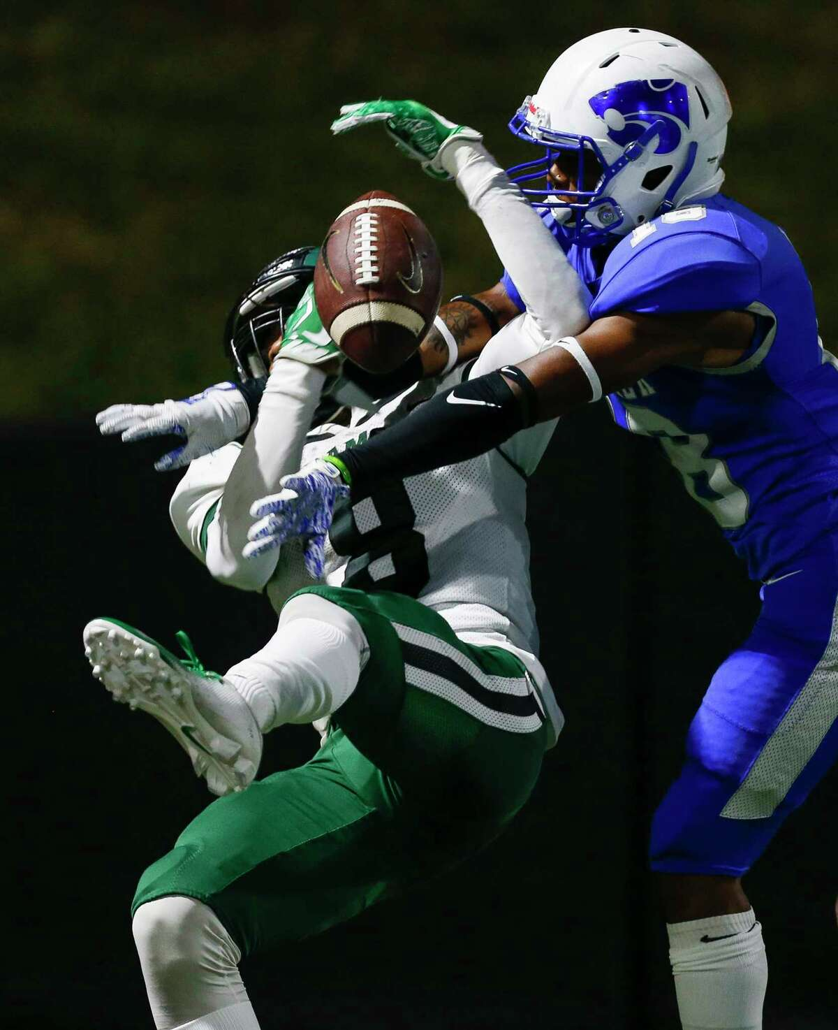 Cy Creek defensive back Kamari (18) breaks up a pass intended for Mayde Creek wide receiver JaCoby Wilson (8) during the second half of the during the Texas State Playoffs Division II Area Round Thursday, Nov. 21, 2019, in Houston. Cy Creek won 35-14.