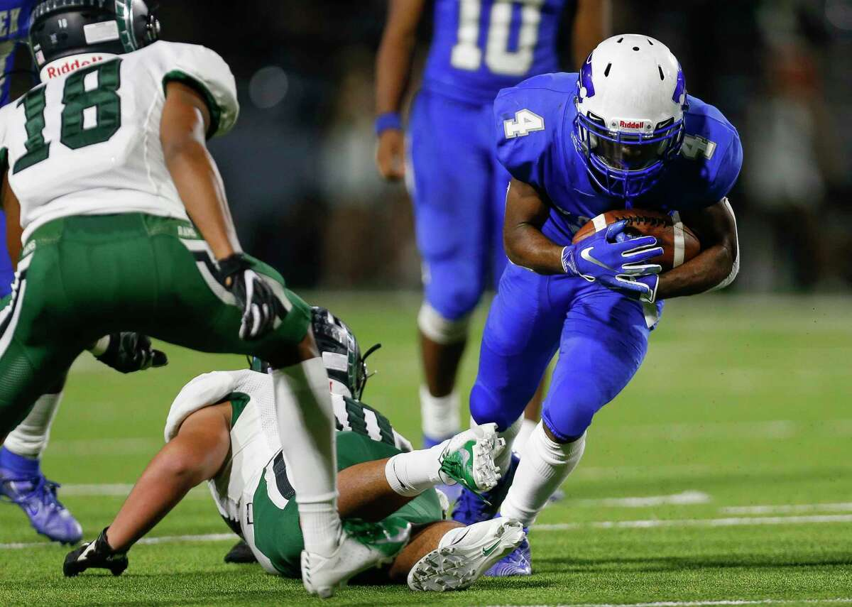 PHOTOS: Cy Creek 35, Mayde Ceek 14  Cy Creek running back Jayden Gilbert (4) runs the ball against Mayde Creek during the second half of the during the Texas State Playoffs Division II Area Round Thursday, Nov. 21, 2019, in Houston. Cy Creek won 35-14.