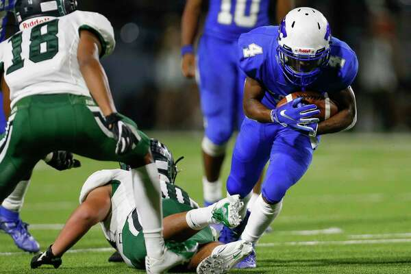 Cy Creek running back Jayden Gilbert (4) runs the ball against Mayde Creek during the second half of the during the Texas State Playoffs Division II Area Round Thursday, Nov. 21, 2019, in Houston. Cy Creek won 35-14.