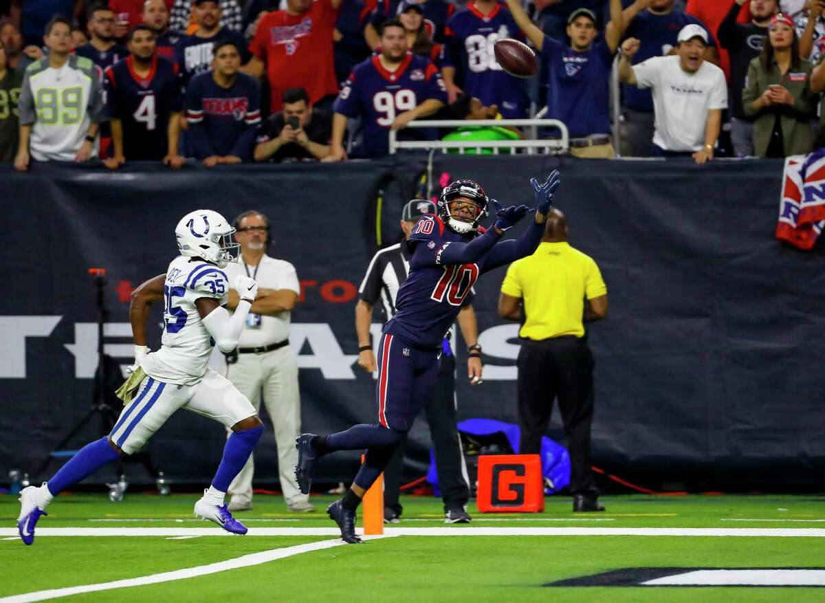 Texans wide receiver DeAndre Hopkins (10) catches a 30-yard touchdown pass Colts cornerback Pierre Desir (35) to give the Texans a 20-17 win.