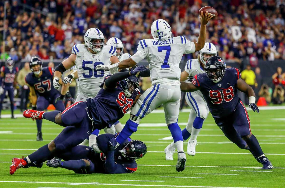 Jacoby Brissett is pressured by the Texans in the fourth quarter. Houston beat Brissett for the first time.