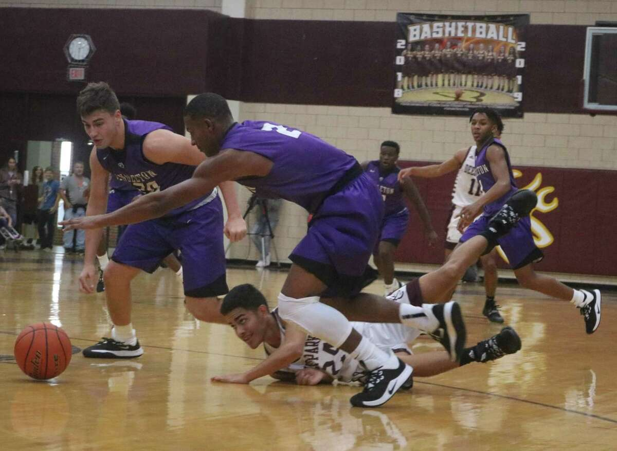 Deer head coach Ryan Bright loved the way his guys hit the floor, diving for loose balls such as this one in the first half against Angleton.