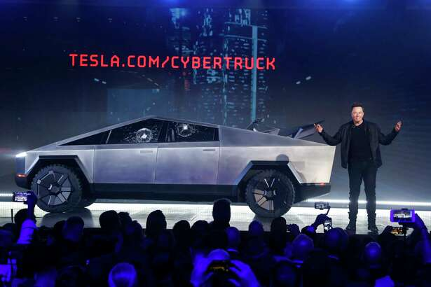 Tesla CEO Elon Musk introduces the Cybertruck at Tesla's design studio Thursday, Nov. 21, 2019, in Hawthorne, Calif. Musk is taking on the workhorse heavy pickup truck market with his latest electric vehicle.
