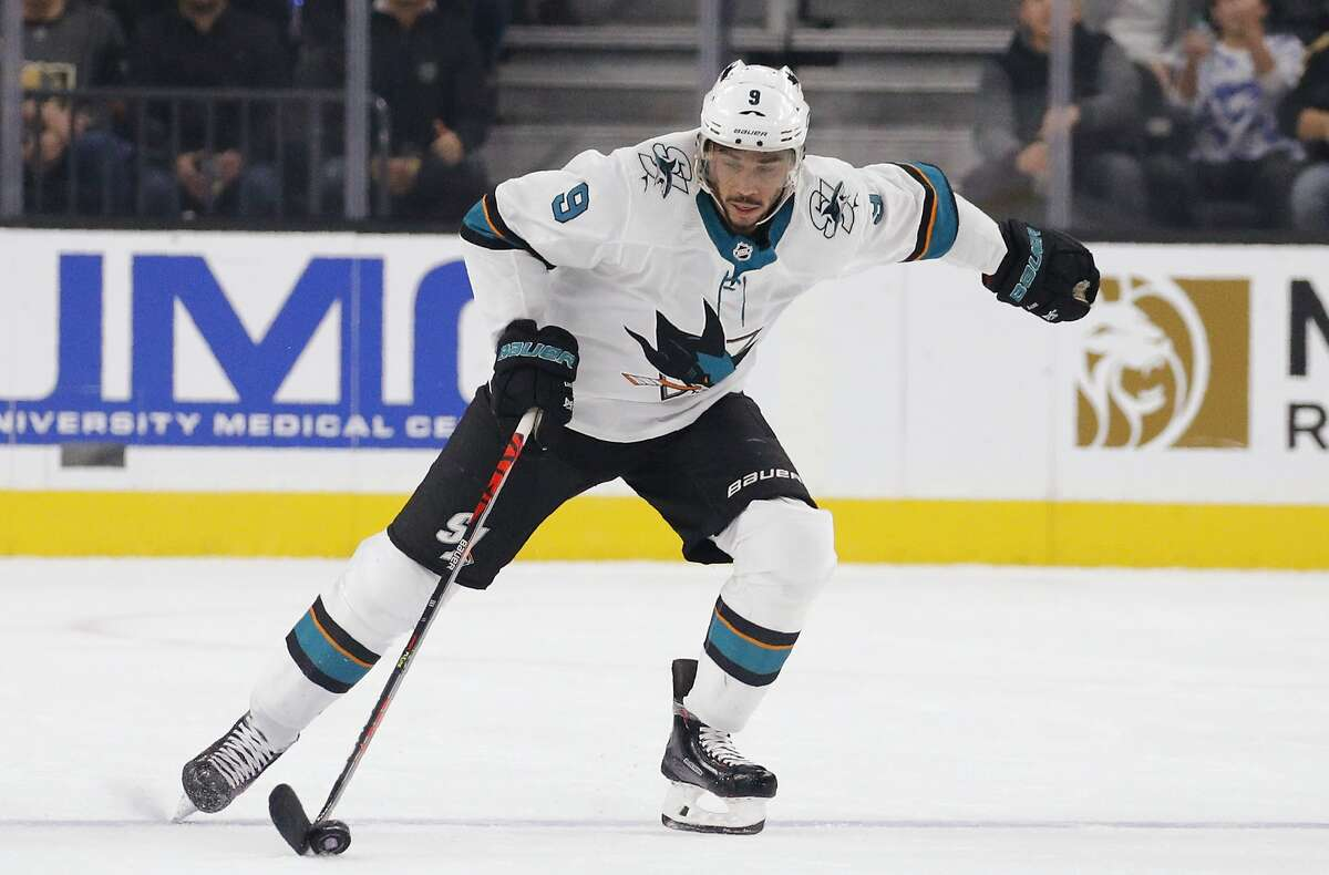 San Jose Sharks left wing Evander Kane (9) skates up the ice against the Vegas Golden Knights during the first period of an NHL hockey game Thursday, Nov. 21, 2019, in Las Vegas. (AP Photo/John Locher)