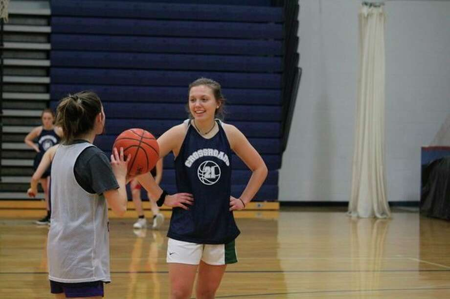 Crossroads girls basketball players Mackenzie Cole and Allie Angell (right) work on their shooting during a practice on Wednesday. (Pioneer photo/John Raffel)