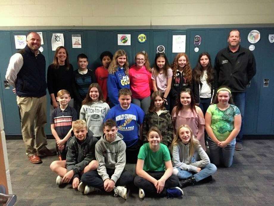 Pictured is October's teacher of the month, Ruth Gullekson; her sixth-grade class; teacher, Jake Wing (back left); and Scott's Body Shop representative, Mike Enszer (back right). (Courtesy photo)