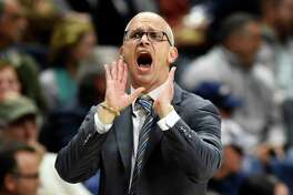 Connecticut head coach Dan Hurley urges his team on in the second half of an NCAA college basketball game against Sacred Heart Friday, Nov. 8, 2019, in Storrs, Conn. (AP Photo/Stephen Dunn)