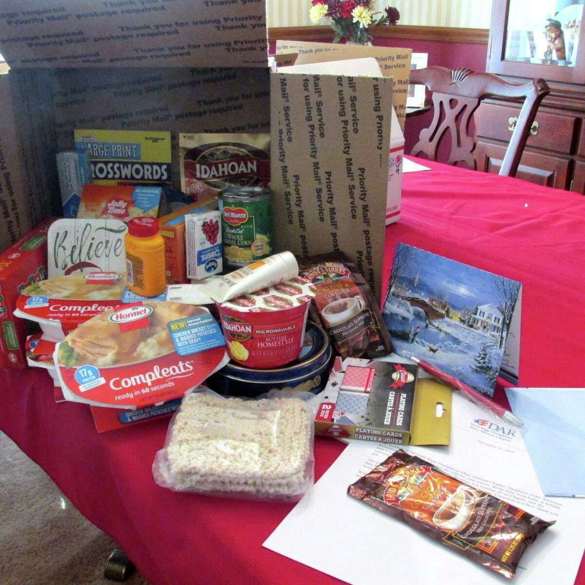 The Sarah Riggs Humphreys-Mary Silliman Chapter of the DAR recently mailed grocery shopping and buy microwaveable foods for a Christmas dinner along with playing cards, personal care items, and some Christmas candy and microwaveable popcorn to send to three service people deployed overseas.