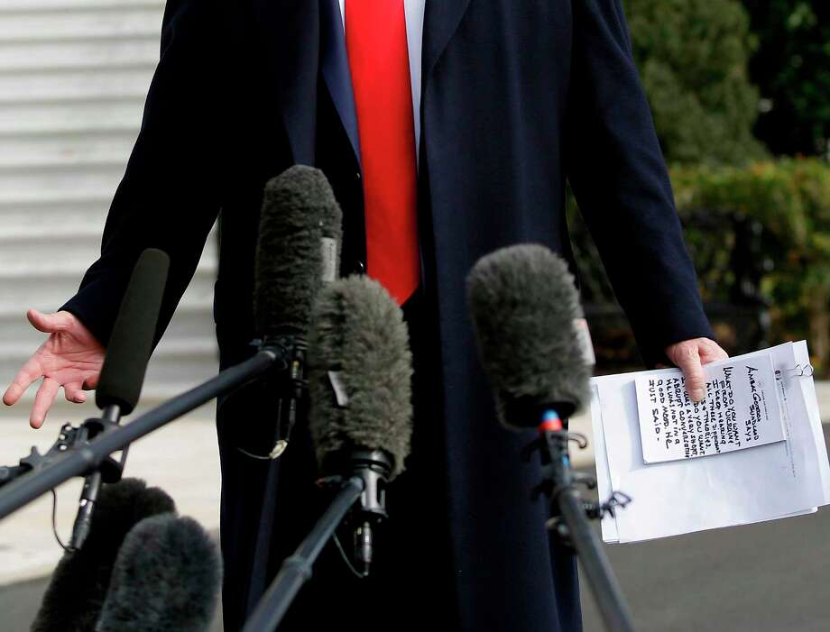 US President Donald Trump reads from his notes as he talks to the media on the South Lawn of the White House before boarding Marine One in Washington, DC, November 20, 2019, en route to Austin, Texas. (Photo by Joshua Lott / AFP) (Photo by JOSHUA LOTT/AFP via Getty Images) Photo: JOSHUA LOTT / AFP Via Getty Images / AFP or licensors