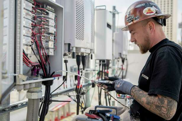 A technician hooks up 5G wireless broadband infrastructure in early 2019 in San Francisco, with the company expanding 5G coverage at year-end to portions of Fairfield County and New Haven County.