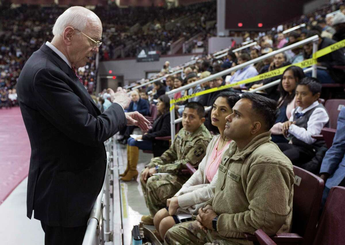 Federal Judge Lynn Hughes, left, talks to Spc. Erlbert Hernandez, left, Spc. Priyanka Kamath and Spc. Dharanendra Chivate, all Army soldiers, before a naturalization ceremony for more than 2,500 new Americans at the M.O. Campbell Educational Center on Wednesday, Nov. 13, 2019, in Houston. Hernandez and Kamath were sworn in as new Americans during the ceremony.