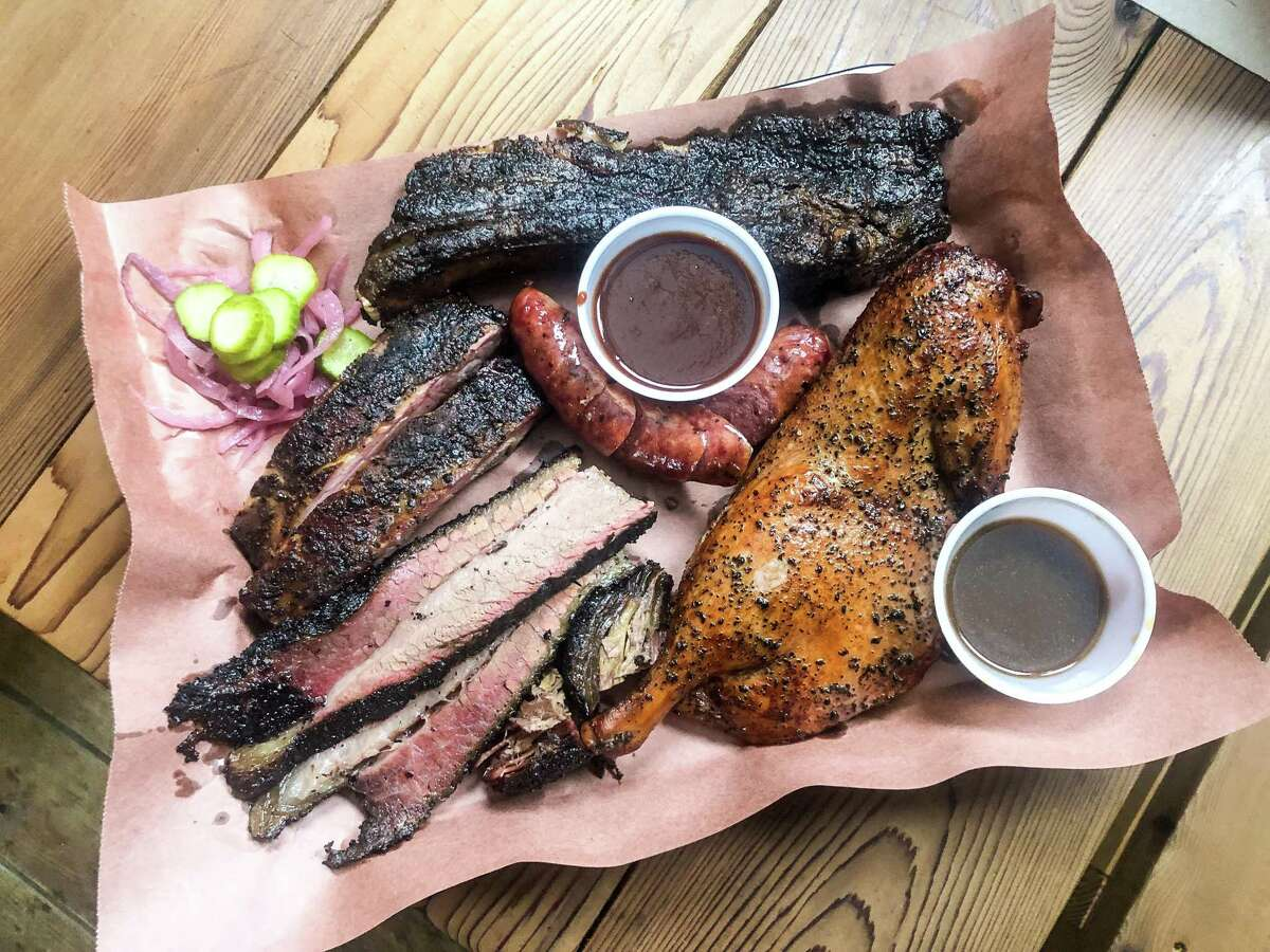 Barbecue tray at Harlem Road Texas BBQ including one-half smoked duck (bottom right).
