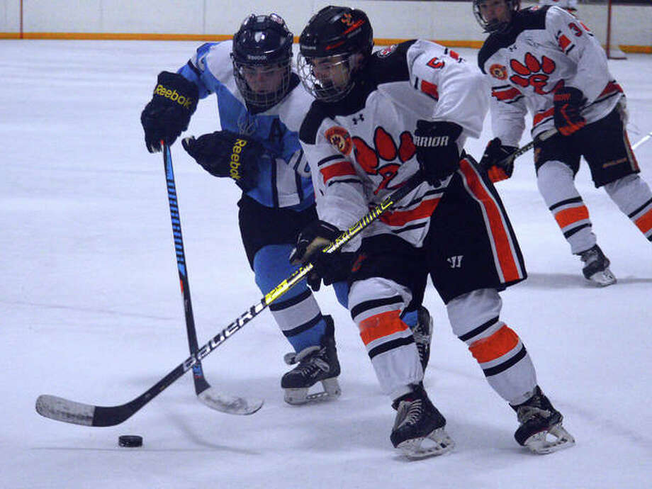 Edwardsville's Matthew Clark, right, tries to get past a Parkway West defender during Thursday's game at the East Alton Ice Arena. Photo: Scott Marion/The Intellligencer