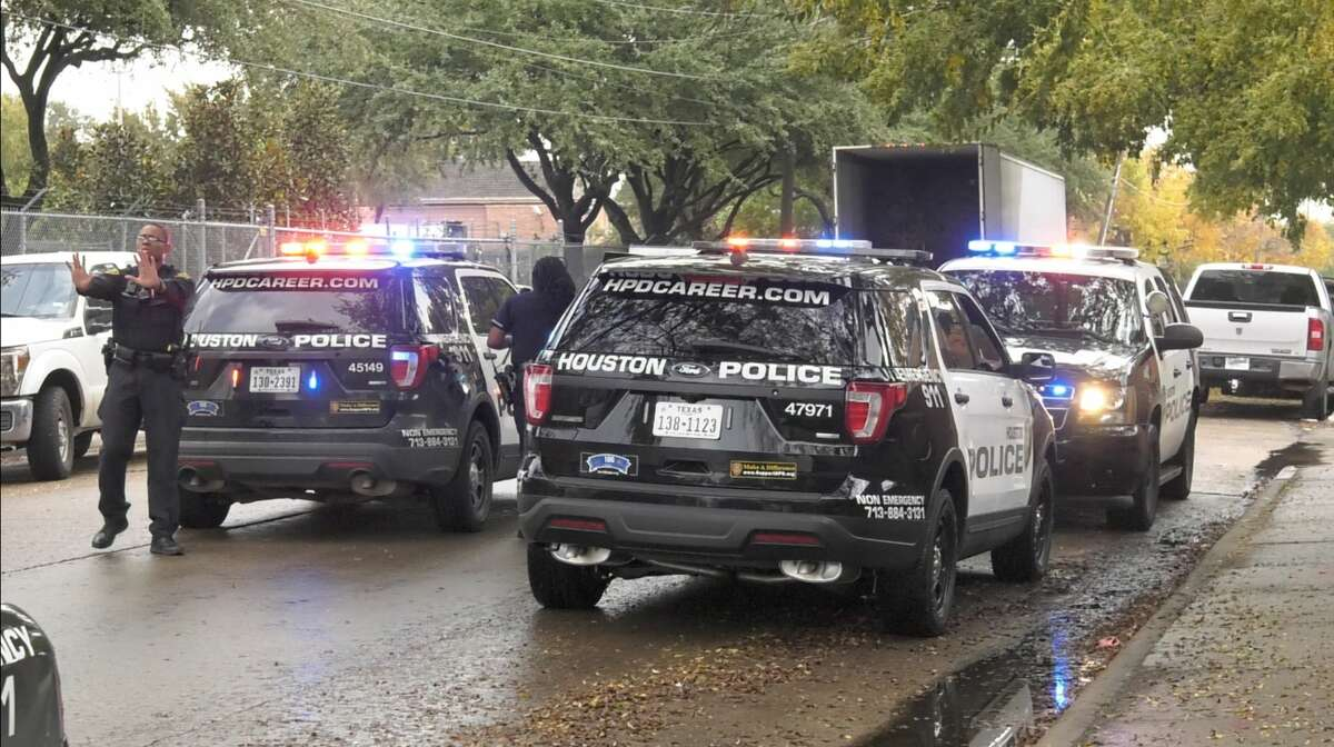 Houston police officers detain a suspect who escaped police custody while wearing handcuffs Friday, Nov. 22, 2019.
