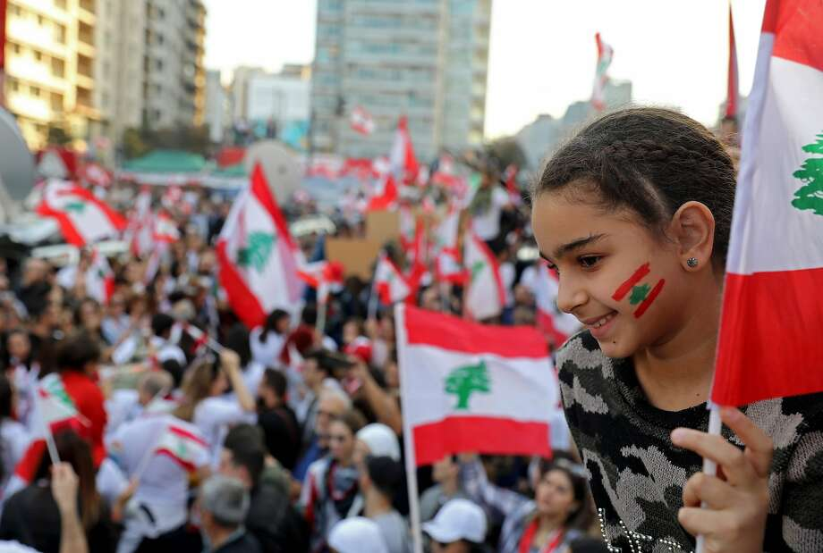 Demonstrators join a civilian Independence Day parade at Martyrs' Square in Beirut. Political leaders attended a truncated military parade that took place at the Defense Ministry. Photo: Anwar Amro / AFP Via Getty Images