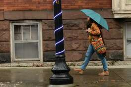 A pedestrian makes her way up Lark St. on a mild rainy day Friday, Nov. 22, 2019 in Albany, N.Y. (Lori Van Buren/Times Union)